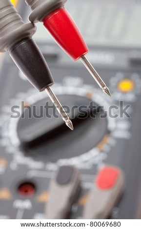 Red and black probes against digital multimeter - stock photo
