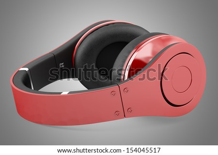 red and black wireless headphones isolated on gray background
