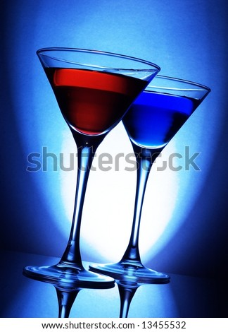 Red and blue cocktails on blue background - stock photo