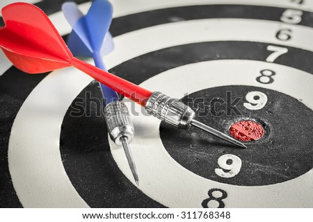 Red and blue dart arrow on dartboard