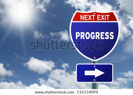 Red and blue interstate road sign Next Exit Progress - stock photo