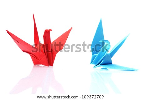 Red and blue origami bird isolated on white background