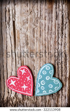 Red and blue paper heart on wooden background, heart shape on grunge wooden background with copy space - stock photo