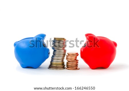 Red and blue Piggybank with coins on White Background - stock photo