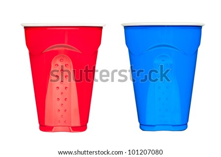 Red and blue plastic, disposable  drinking cups, typically used at picnics and parties, isolated on white. - stock photo