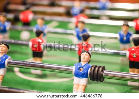 Red and blue player on football table game, soccer table game from top down, Sport Background concept - stock photo
