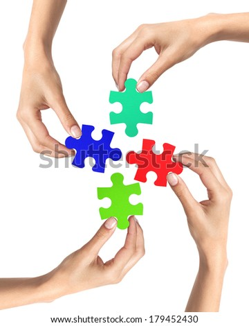Red and blue puzzle in woman hands isolated on white background