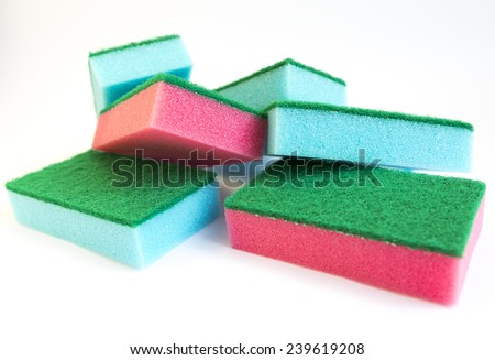 Red and blue sponge isolated on white. - stock photo