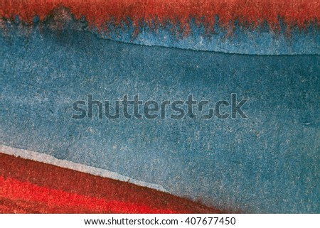 Red and blue stains on brown paper. - stock photo