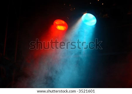 red and blue theater lights with smoke - stock photo