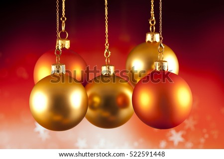 Red and gold baubles on red background