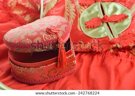 Red and gold box in the shape of a heart and qipao  traditional chinese dress  for chinese new year gift - stock photo