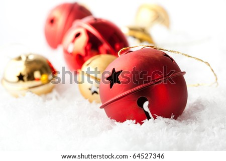 Red and gold Christmas baubles resting in snow - stock photo