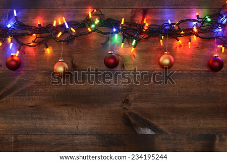 red and gold christmas ornaments with lights - stock photo