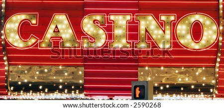 Red and gold color neon casino sign - stock photo