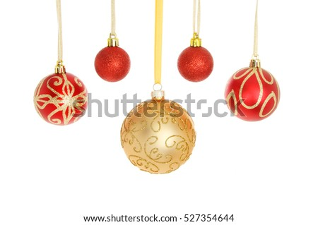 Red and gold glitter Christmas baubles isolated against white