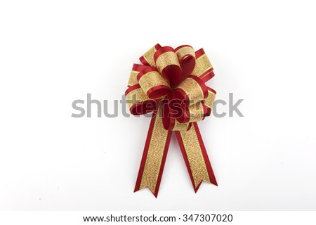 Red and gold ribbon bow isolated on white. this have clipping path  - stock photo