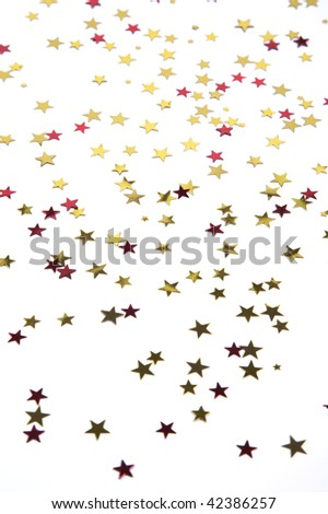 Red and gold stars on a white background, selective focus - stock photo