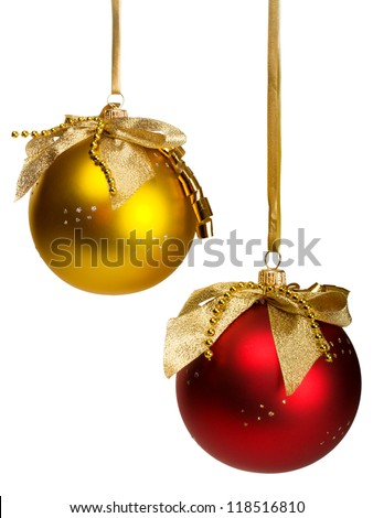 red and golden christmas  balls hanging on ribbons