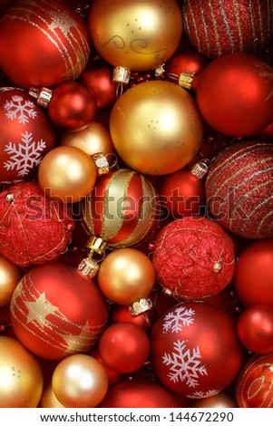 Red and golden Christmas ornaments. - stock photo