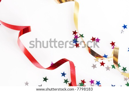 red and golden ribbons and small confetti stars, party time - stock photo