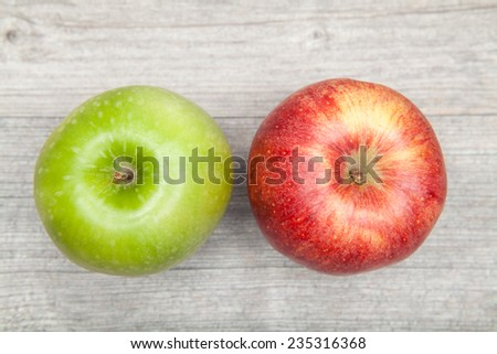 red and green apple on table - stock photo