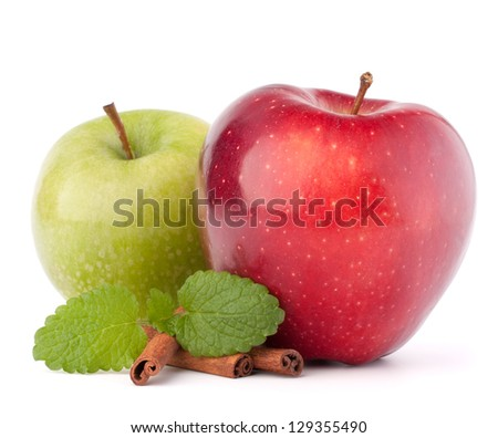 Red and green apples, cinnamon sticks and mint leaves still life isolated on white cutout - stock photo
