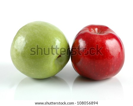 red and green apples in white background - stock photo