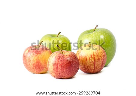Red and green apples on white background. - stock photo