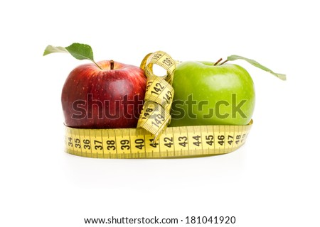 red and green apples with measuring tape Isolated on white background - stock photo