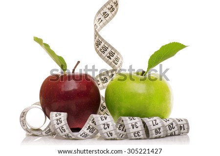 red and green apples with measuring tape Isolated on white background. Diet concept.