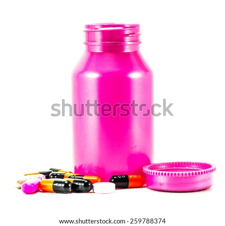 red and green capsules with bottle - stock photo