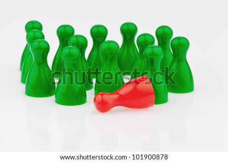 red and green characters. bullying, loneliness and outsider in the team. - stock photo