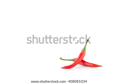 Red and green chili pepper on a white background - stock photo