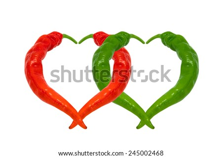 Red and green chili peppers in love. Hearts composed of peppers. Isolated on white background. - stock photo
