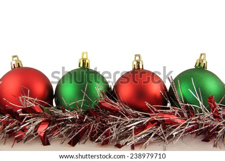 Red and Green Christmas Ornament on White Background - stock photo