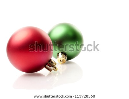 red and green christmas ornaments on white isolated background - stock photo