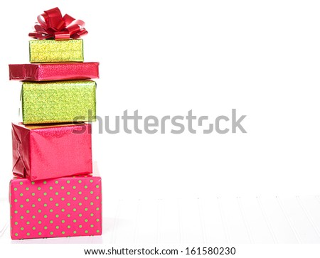 Red and Green Christmas presents stacked with an isolated white background - stock photo