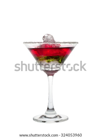 Red and green colored cocktail in martini glass