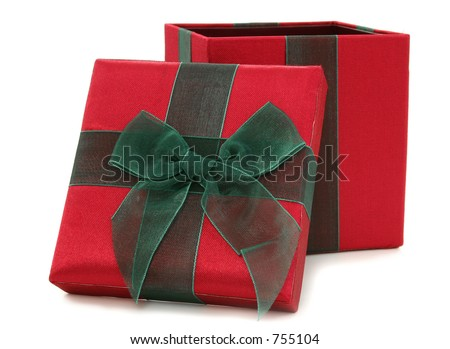 Red and green fabric gift box over white.