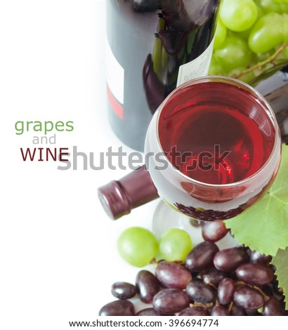 Red and green grapes, wine glass and bottle of wine isolated on white - stock photo