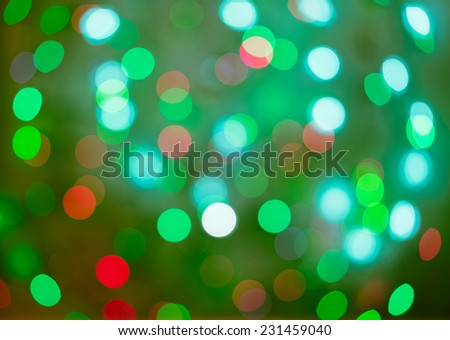 Red and green holiday bokeh. Abstract Christmas background, christmas lights backround - stock photo