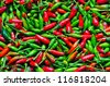Red and green hot peppers background - stock photo