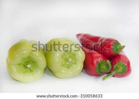 Red and green paprika on the white background.