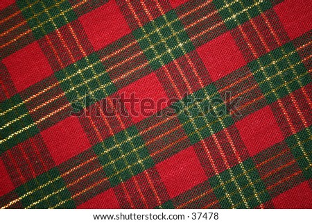 Red and green plaid table cloth. - stock photo