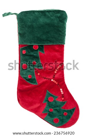 Red and green plush Christmas stocking isolated on white background - stock photo