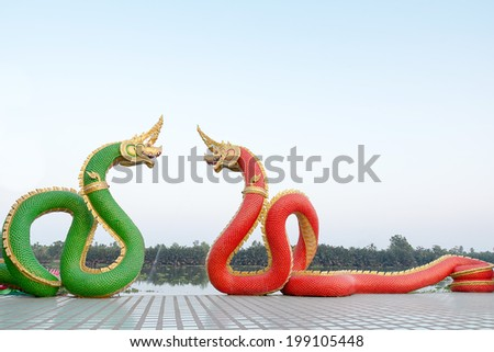 Red and green serpent statue , Thailand - stock photo