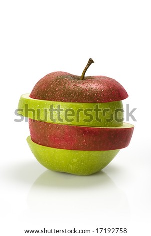 Red and green sliced apple with moisture - stock photo