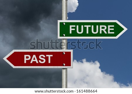 Red and green street signs with blue and stormy sky with words Future and Past, Future versus Past - stock photo