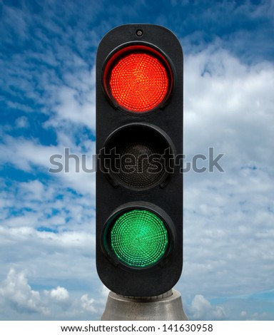 Red and Green traffic lights against blue sky backgrounds. Clipping Path included. - stock photo